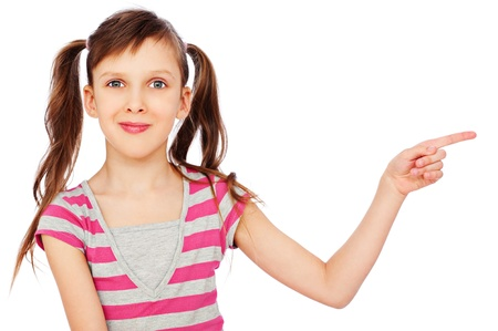 portrait of smiley little girl pointing at something. isolated on white background  photo