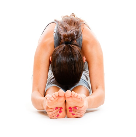 young woman doing stretch exercise. isolated on white background Stock Photo - 10822183