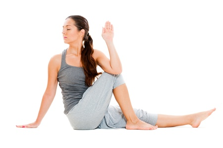 portrait of young woman doing flexibility yoga exercise. isolated on white background photo