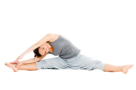 young woman doing stretch exercise on floor. isolated on white background photo