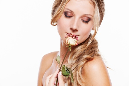 portrait of beautiful young woman with rose on white photo