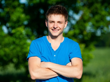 young man jeans: portrait of cheerful young man in blue t-shirt