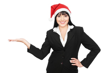 smiley christmas businesswoman holding something on his palm. isolated on white background  photo