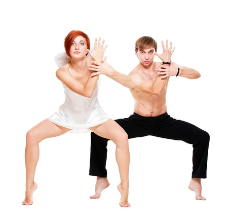 couple of dancers posing over white background photo
