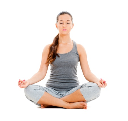 meditation isolated white: calm pretty woman doing yoga exercise. isolated on white background Stock Photo