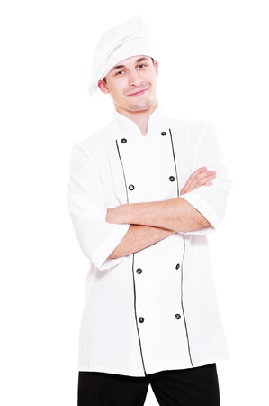 smiley young cook standing over white background photo