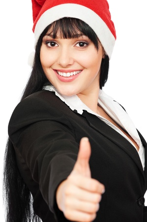 successful happy businesswoman in santa hat showing thumbs up over white background photo