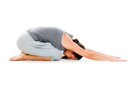 workouts: woman doing yoga workouts on floor. isolated on white background