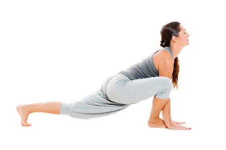 young woman doing flexibility exercise on floor. isolated on white background Фото со стока