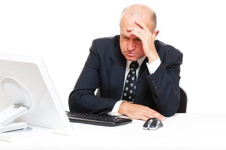 grievous: sad senior businessman sitting in office