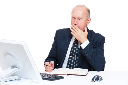 slumberous: tired senior businessman in office over white background