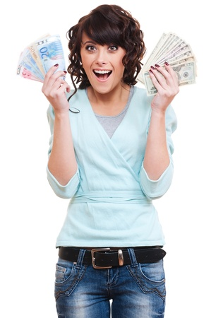woman holding money: portrait of excited young woman holding money in her hands. isolated on white background