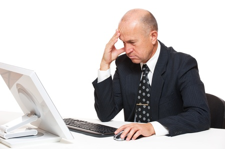 computer problem: portrait of sad businessman looking in monitor on office Stock Photo