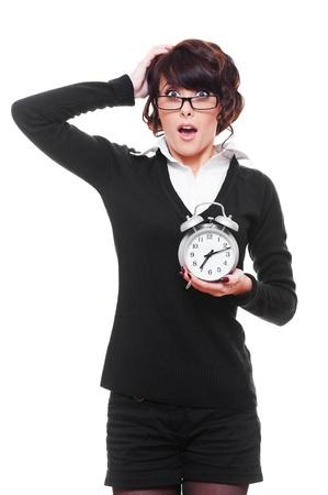 shocked woman holding alarm clock. isolated on white background photo