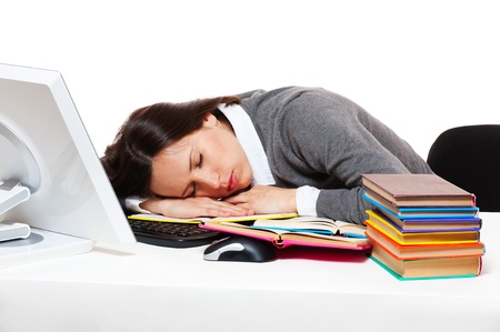 tedium: tired student sleeping on her workplace  Stock Photo