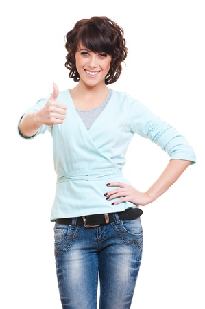 prosperous: successful young woman showing thumbs up. isolated on white background