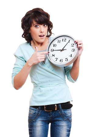 portrait of amazed woman with clock over white background  photo
