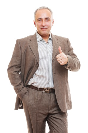 portrait of cheerful senior business man in suit showing thumbs up Stock Photo - 12428963
