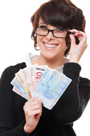 smiley young businesswoman holding euro in her hands. isolated on white background  photo