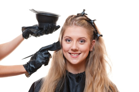 hairdresser doing hair dye. isolated on white background photo