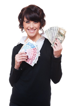 currency exchange: happy businesswoman holding dollars and euro in her hands. isolated on white background