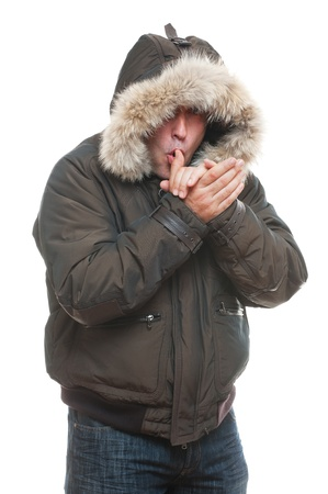chilly: man in jacket warming oneself. isolated on white background