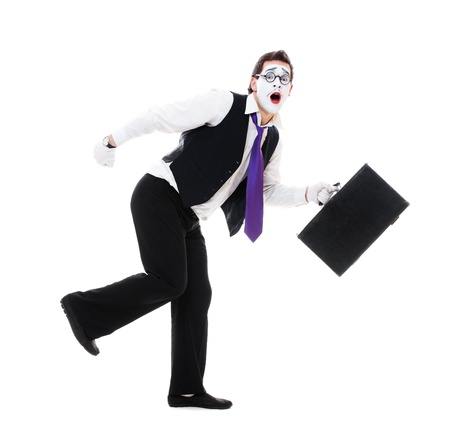 mime with hand luggage running. isolated on white background photo