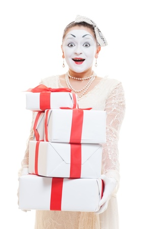 mimic: amazed mime woman  holding many boxes of presents. isolated on white background