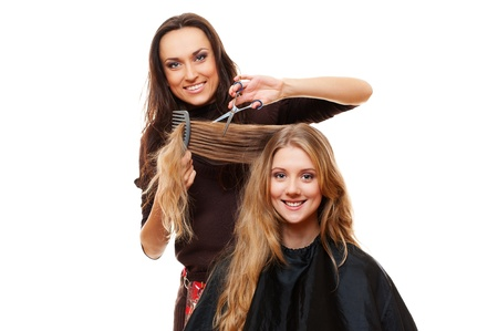 trims: smiley hairdresser with client. isolated on white background