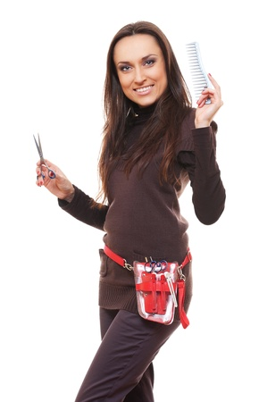 stylist: smiley hairdresser with tools against white background  Stock Photo