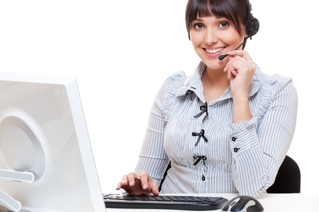portrait of smiley telephone operator at workplace  photo