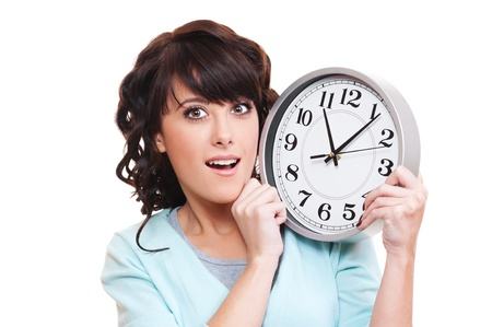 portrait of surprised woman with clock over white background  photo