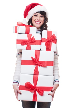happy young woman in santa hat holding gift boxes. isolated on white background  photo