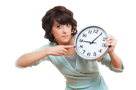 portrait of young woman with clock. isolated on white background Stock Photo - 12428761