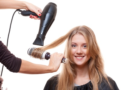 dry: hairdresser blow dry hair. isolated on white background