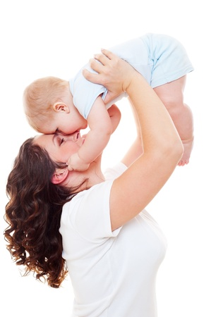mom kiss son: portrait of happy mother with son over white background  Stock Photo