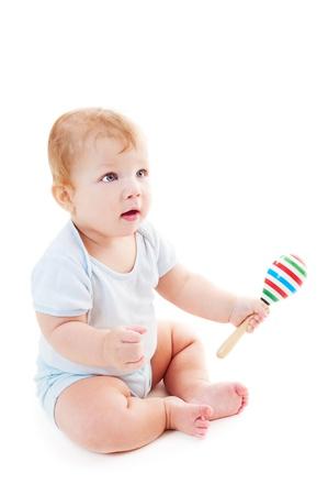 Retrato de niño con el sonajero. aisladas sobre fondo blanco Foto de archivo - 12428958