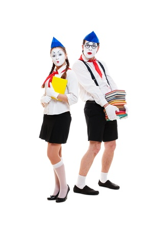 portrait of mimes with books. isolated on white background photo