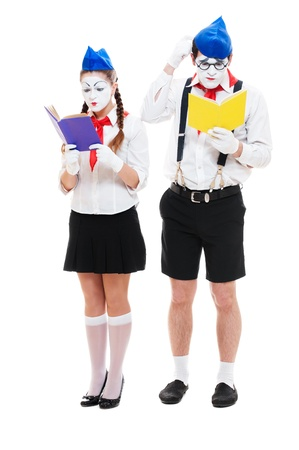 portrait of reading mimes with books. isolated on white background photo