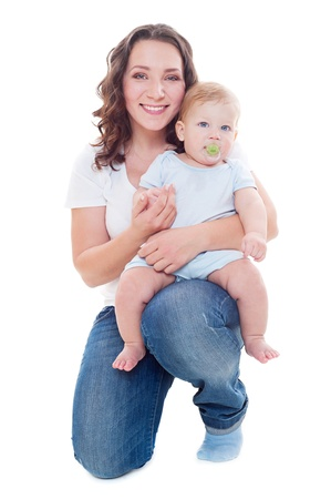 mom holding baby: studio shot of young smiley mother with her son