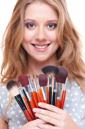 bright picture of smiley woman with make-up tools photo