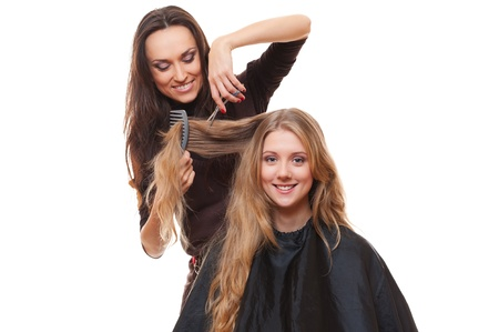 barber salon: studio picture of hairdresser and smiley woman. white background