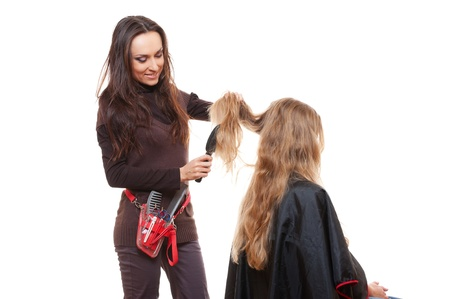 studio shot of hairdresser doing her work. white background photo