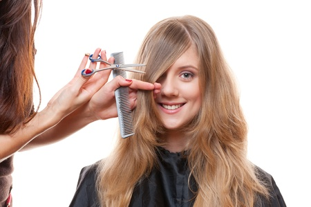 hairdressing scissors: Studio shot of smiley woman and hairdresser. white background Stock Photo
