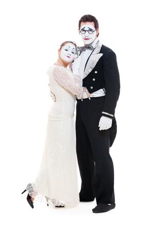 pantomima: foto de estudio de dos mimos aisladas sobre fondo blanco