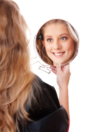 young woman with mirror over white background photo