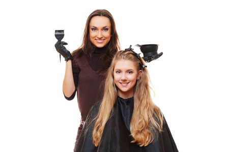 studio picture of hairdresser doing hair dye. isolated on white photo
