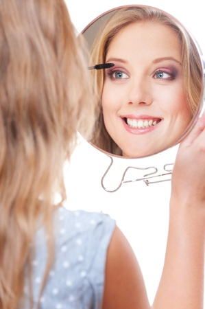 esthetician: studio picture of smiley young woman with miror. white background