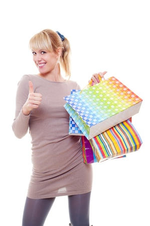 studio picture of woman with bags showing thumbs up. isolated on white photo