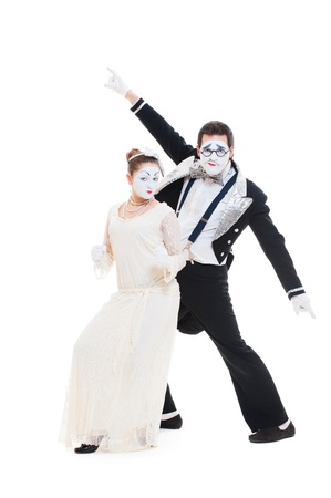 studio shot of funny dancing mimes. isolated on white photo